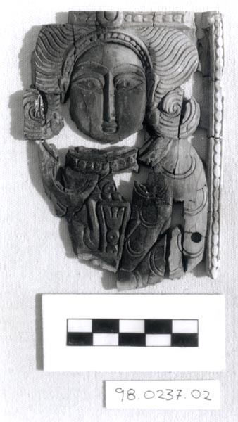 ivory panel with figure